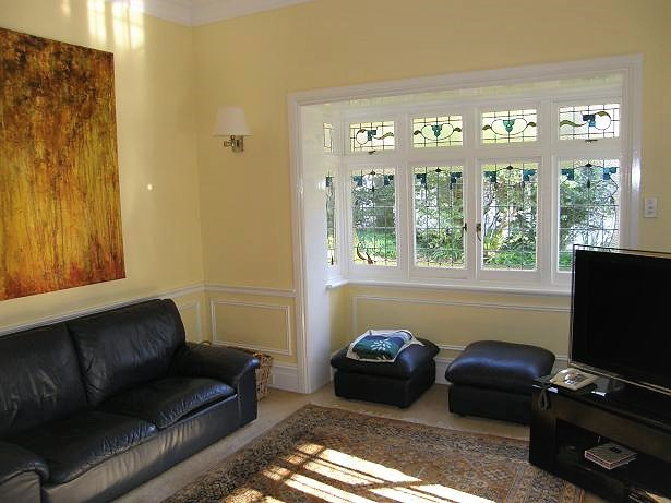 A nicely decorated living room with bay window.